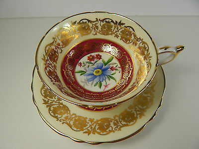 Paragon Tea Cup and Saucer. Gold Ornate Pattern, Blue Flower.