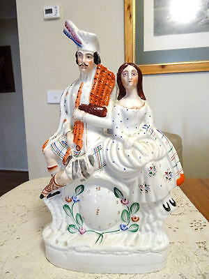 C1860S Staffordshire Flatback Scotsman And His Lady  Seated Over Clock Face