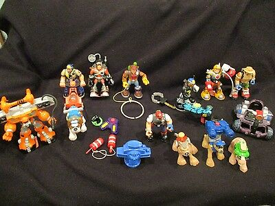 lot of rescue hero's with some accessories and vehicles