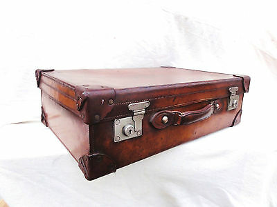 A Gentleman's Antique Leather Silver Fitted Suitcase