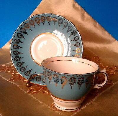 COLCLOUGH c.1950s TURQUOISE AQUA and GOLD, HARLEQUIN TEA CUP AND SAUCER