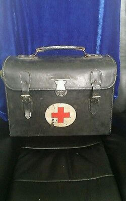 Vintage medical carrying case with red cross sign and handle