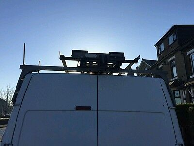 Van roof rack and tow bar