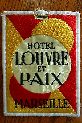 vintage luggage tag from Historic Hotel LOUVRE et PAIX, MARSEILLE, France