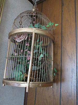 """Large Metal & Wood Bird Cage with flowers inside, Approx. 22"""" tall 11.5 Dia."""