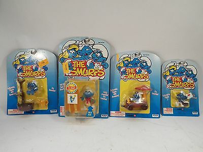 Lot of 4 The Smurfs Collectible Action Figures - New in Packages - 1995 & 1996