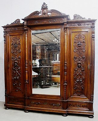 Antique Walnut Highly Carved French Armoire/ Wardrobe Triple Door Circa 1890