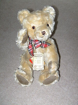 Hermann Original German teddy bear. Mohair with stud and tags. Golden growler.