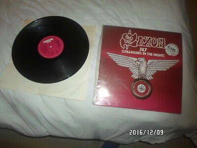 a 12 inch single vinyl record saxon 747 strangers in the night