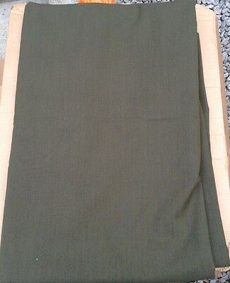Green suiting trousers skirts fabric aprox 4.5 meters by 1.5