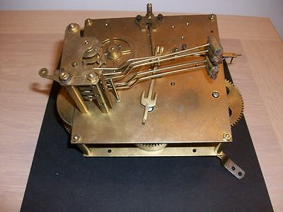 AN EARLY CLOCK CHIMING MOVEMENT  MARKED 12cm