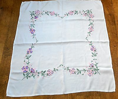 Vintage hand embroidered tablecloth with flowers around the sides and corners