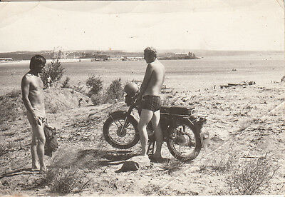 Romania Seaside Tourists With Old Classic Motorcycle On The Beach