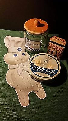 Pillsbury Doughboy collectibles lot: jigsaw puzzle, 2 tins, glass cookie jar