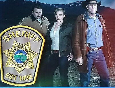 Longmire cast 8x10 photograph with Fictional Absaroka County Sheriff's Patch