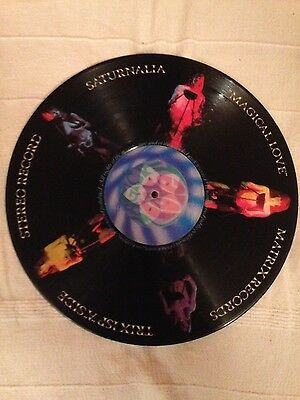 Original Saturnalia Magical love vinyl with hologram centers .