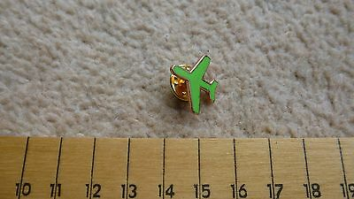 Aircraft shaped lapel pin, green in colour, new and unused, no packaging