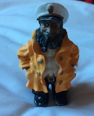 """A 5"""" High FIBRE FIGURE OF A SAILOR, FISHERMAN, CAPTAIN WITH PIPE."""