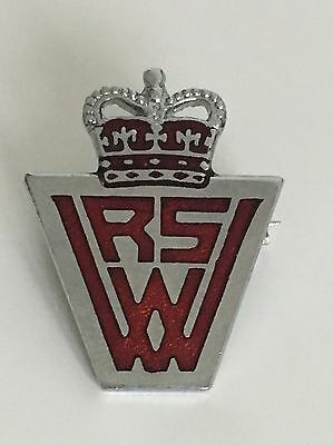 Unusual Little Metal Pin Badge With A Crown Atop The Letters R S W