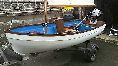 boat with galvanised trailer 4 stroke outboard and sail kit fantastic condition