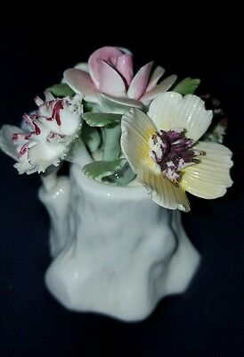 royal doulton flowers in a tree stump