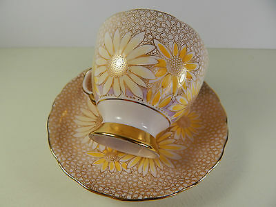 Tuscan Gold Laced Chintz Daisy Tea Cup and Saucer.