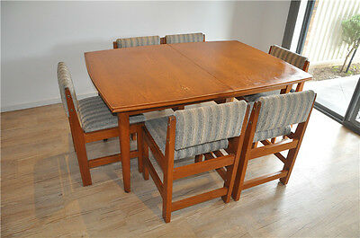 Expandable solid wood dining table and 6 chairs