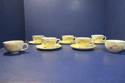 "Homer Laughlin ""Golden Wheat"" Coffee Cups (7) & Saucers (5)"
