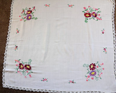 Vintage white hand embroidery tablecloth with red/purple flowers, crochet edge.