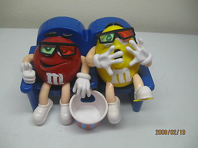 M&M'S Candy Dispenser At The Theater In 3-D Featuring Red And Yellow