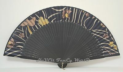 Silk Cloth black colored base with black colored bamboo Yellow Flowers Hand Fan