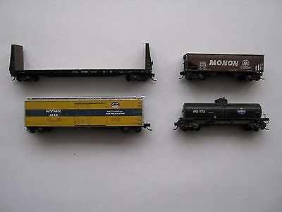 4 x Micro trains freight cars - weathered - boxed