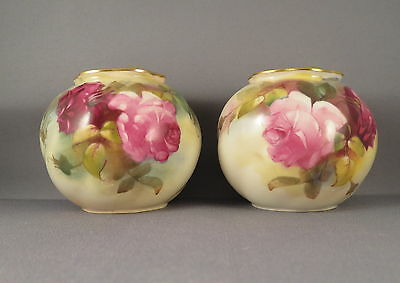 Rare duo of Worcester bulbous wrythen G161 vases hand painted with roses