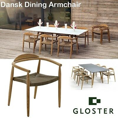 4 of 8 Gloster Dask garden teak stacking chairs . Each cost 718