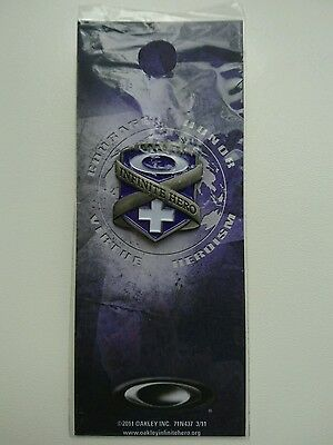 Oakley Infinite Hero collectable pin badge and backing card brand new and unused