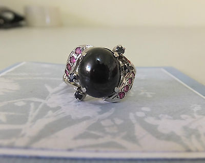 Silver Ring Black Star of India with pink stones on swirls each side of stone