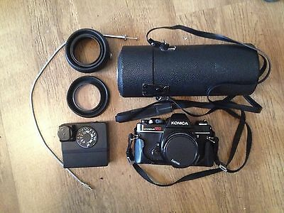 Vintage Konica AutoReflex camera with lenses in case, camera not working