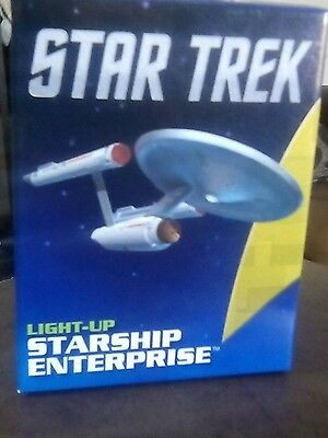 The star trek starship  Enterprise lights up with stand and booklet