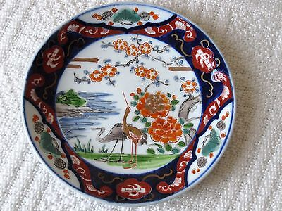 Hand painted Japanese plate. Signed and impressed seal mark