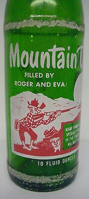 """Vintage 1965 Mountain Dew Filled By """"Roger and Eva"""" 10 ounce Soda Bottle"""