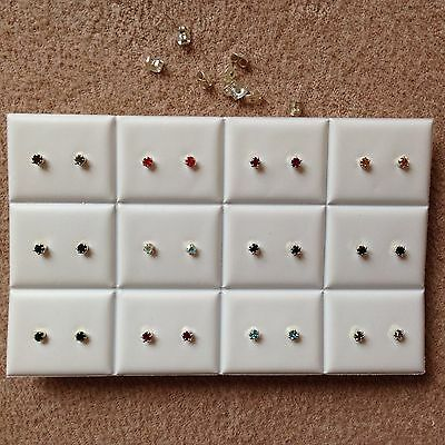 JOB LOT-12 pairs of 10 different colours 0.4cm crown set stud earrings.UK made.