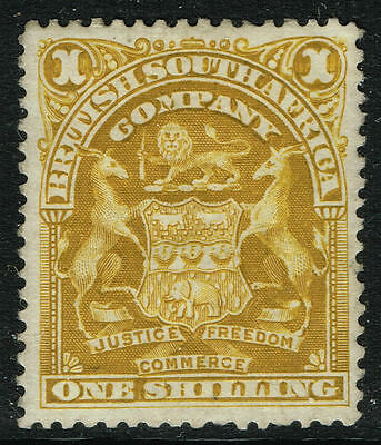 SG 84 RHODESIA 1898 - 1s BISTRE - MOUNTED MINT