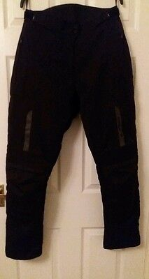 Motorcycle waterproof trousers textile with thermal liner. Women's medium