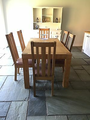 Oak Table With 6 Leather Cushioned Oak Chairs