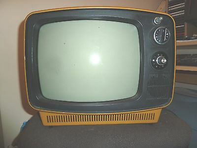 "Orange coloured case National portable 12"" TV set in unknown condition"
