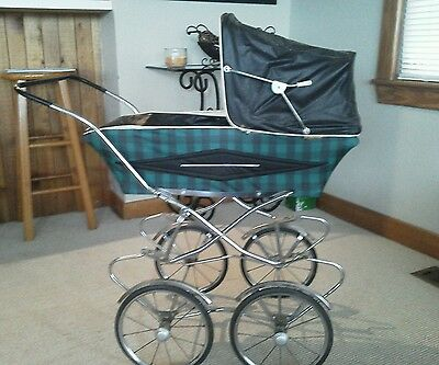Vintage doll stroller pram with vintage pillows
