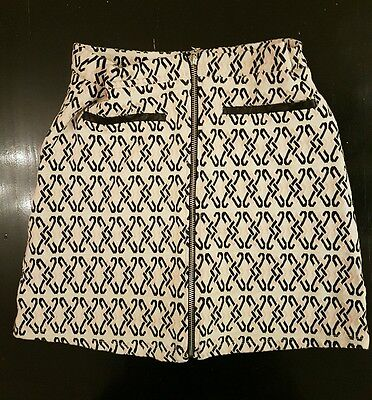Girls River Island Patterned skirt.Size Age 12-13