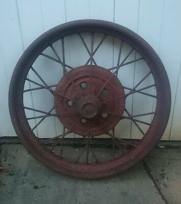 Vintage ford wire wheel. Antique car. Man cave.