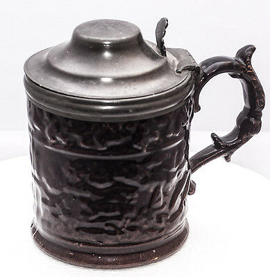Glazed brown pottery relief tankard with pewter lid beer stein brewerania