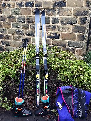 Ski's with boots and poles